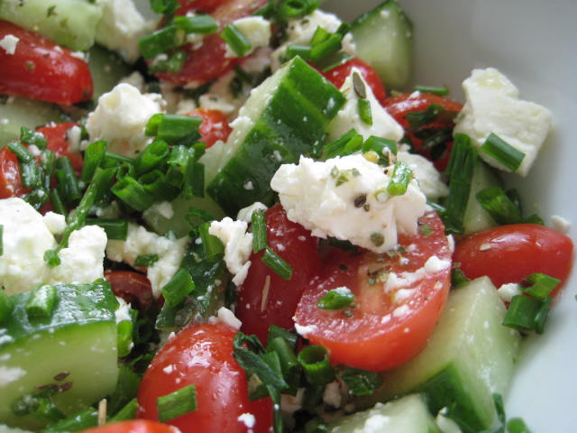 Cucumber, feta cheese and tomato pieces in bowl