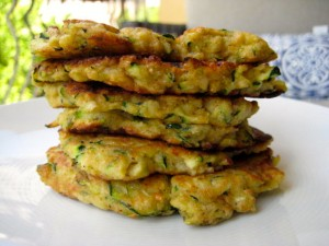 Pancakes made with shredded zucchini, onions and flour.